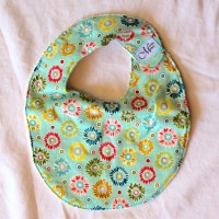 Small Green, Yellow, Pink and Blue Scribbled Flower Bib