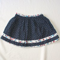 Red and Blue Flower/Navy with Silver Stars Reversible Skirt – Size 12-24 months