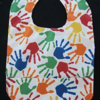 Primary Color Handprint Wipeable Bib